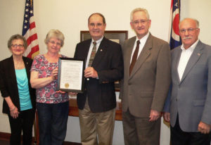 Members of the Salem National Day of Prayer Committee receive a copy of a proclamation from Salem Mayor John Berlin declaring May 4 as a Day of Prayer for Salem. Committee members shown with the mayor, center, include from left, Theresa Morris, Becky Craig, Rev. Daniel Hardy, who's president of Allegheny Wesleyan College, and Jim Kelly. Not present were committee members Karen McElwee and J.C. Siembida. The 11th annual observance in Salem begins at noon Thursday on the village green at the Salem Area Chamber of Commerce on the corner of State and Lincoln. (Salem News photo by Mary Ann Greier)