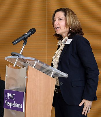 Leslie Davis, senior vice president and executive vice president and chief operating officer-Health Services Division, UPMC speaks at the event to mark the affiliation of Susquehanna Health and UPMC.