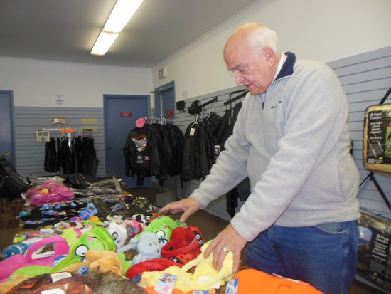 MIKE REUTHER/Sun-Gazette Butch Bradley sorts merchandise in his Lycoming Creek Road store.