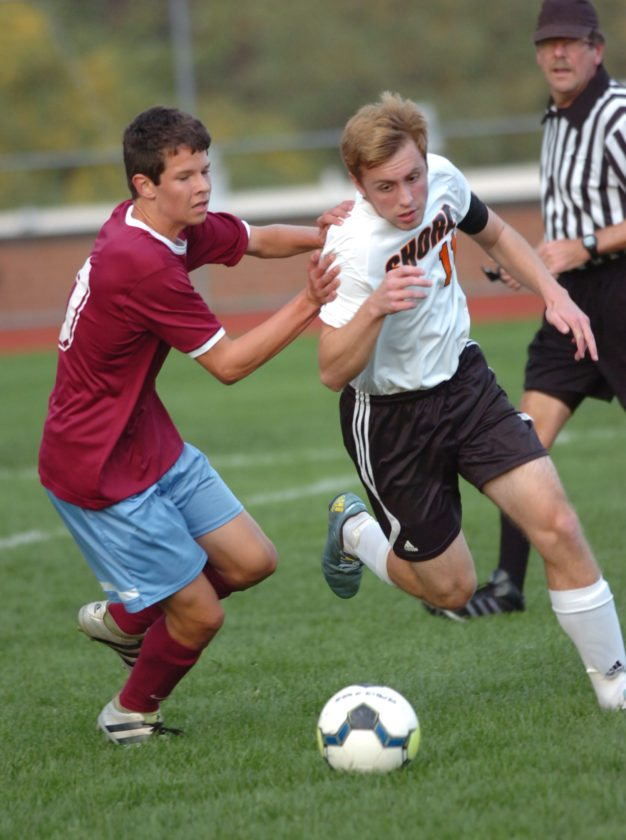 Loyalsock's Ty Whitmoyer, left, and Jersey Shore's Jacob Corson battle for control of the ball during the first half at Jersey Shore on Thursday. MARK NANCE/Sun-Gazette