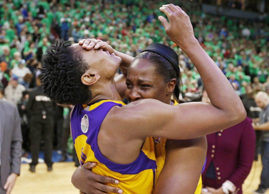 The Los Angeles Sparks' Alana Beard, left, and Chelsea Gray celebrate after the Sparks beat the Minnesota Lynx, 77-76, to win the WNBA Finals championship on Thursday in Minneapolis.