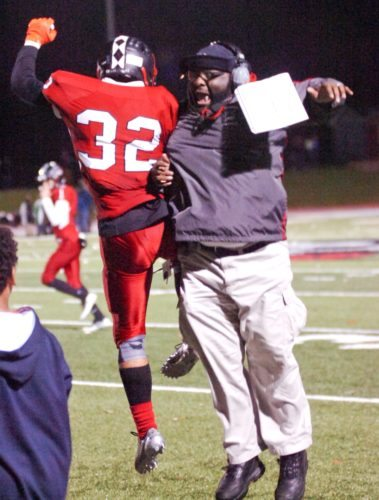Coach Chuck Crews and Elliott Walker celebrate during Williamsport's win over Wyoming Area Friday night.