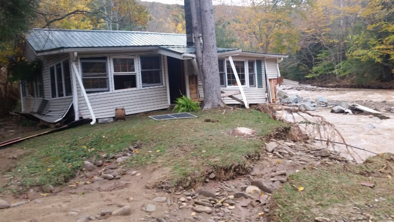 PHILIP A. HOLMES/Sun-Gazette Don and Sandra Swarthout's home, above, just off of Pleasant Steam Road in McIntyre Township, was destroyed by Friday morning's flash flood, which pushed the property at least 40 feet down stream.
