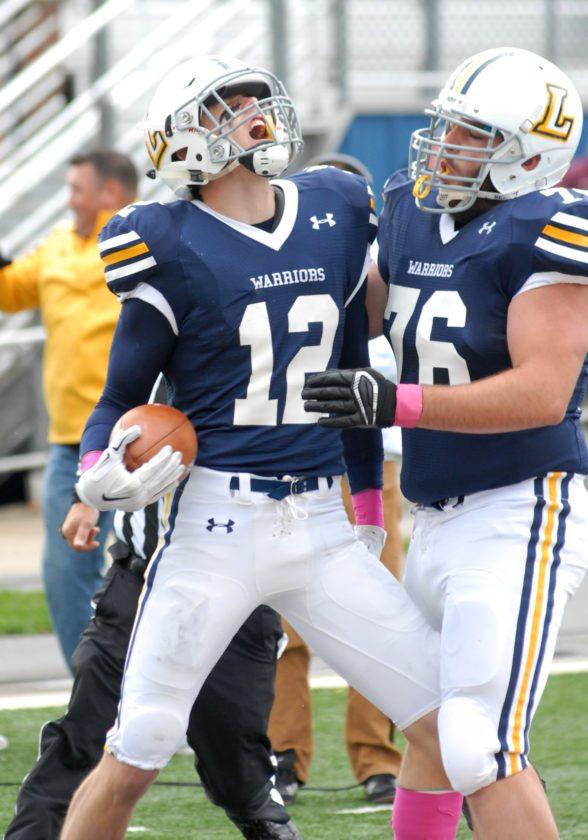 MARK NANCE/Sun-Gazette Lycmong College's Aaron Davis (12) and Levi Meyers (76) celebrate after Davis's second quarter touchdown.