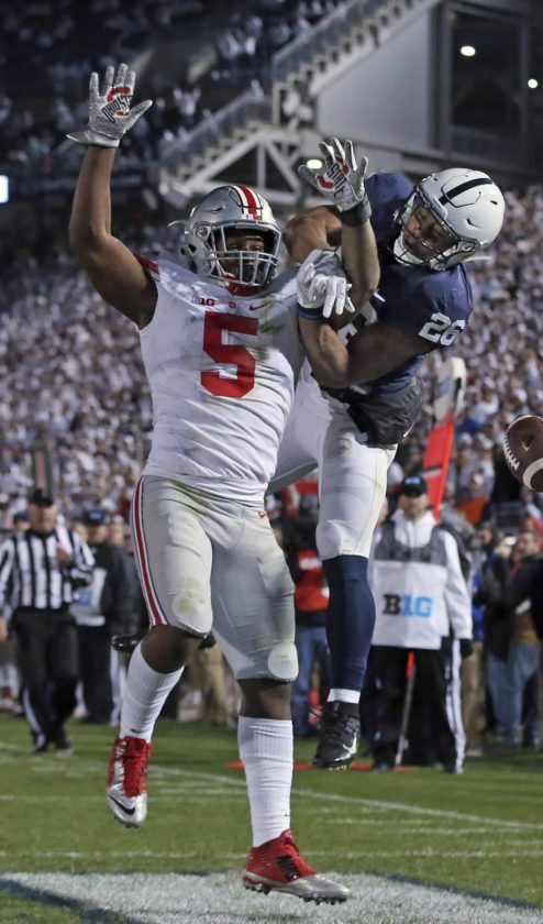 Penn State's Saquon Barkley can't hang onto a pass in the end zone as Ohio State's Raekwon McMillan defends during the first half in State College on Saturday at Beaver Stadium. Penn State upset No. 2 Ohio State, 24-21.