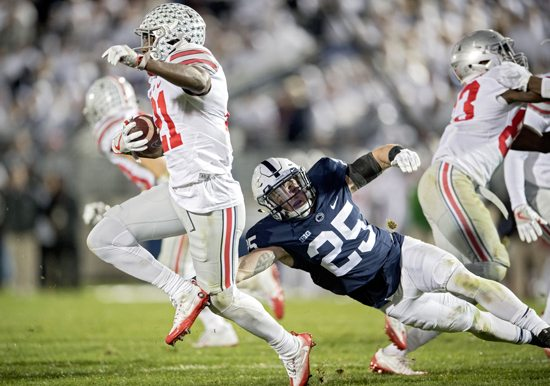 Penn State's Von Walker stops Ohio State's Parris Campbell as he tries to return a kickoff during an NCAA college football game Saturday, Oct. 22, 2016, in State College, Pa. Penn State won 24-21. (Abby Drey/Centre Daily Times via AP)