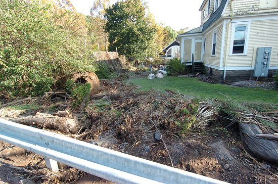 MARK NANCE/Sun-Gazette         Debris lies in the backyard of a home along Mill Creek in Warrensville following flooding Friday.