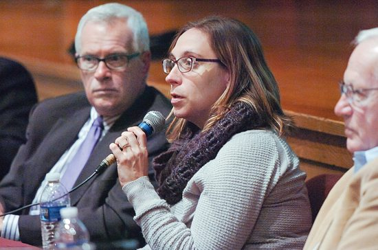MARK NANCE/Sun-Gazette Panelists Kathleen Hugo, of Crossroads Counseling, answers a question as Barry Denk, of the Center for Rural Pennsylvania, left, looks on during Heroin in Loyalsock Town Hall Program at Loyalsock Township High School Thursday.