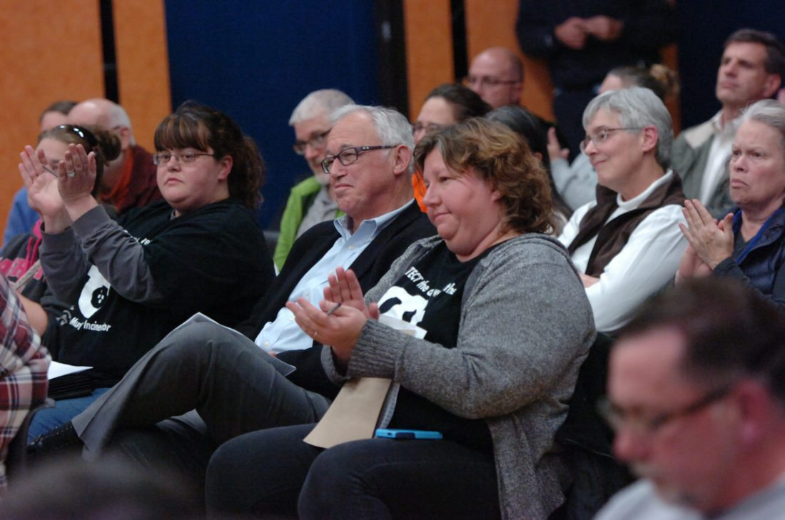 MARK NANCE/Sun-Gazette  Robert VanNaarden, president of Delta Thermo Energy Inc., is seated between Crystal Millard, right, and another leader of the Ban the Muncy Incinerator group as they applaud comments against the proposed plant.