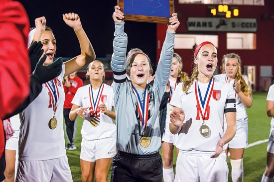 DANIELLE FIORINI/For the Sun-Gazette Members of the Williamsport girls soccer team celebrate after defeating Delaware Valley on Wednesday at the Ball Mills Soccer Complex to win the District 2-4 Class AAAA championship. It's Williamsport's first girls soccer district championship.