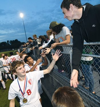 MARK NANCE/Sun-GazetteWilliamsport's Leo Daverio (8) and team mates are congratulated by fans after beating Delaware Valley for the District Championship at Balls Mills Wednesday.