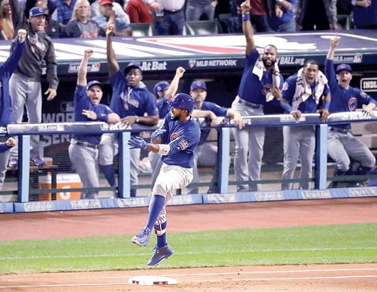 Chicago Cubs' Dexter Fowler celebrates after a home run against the Cleveland Indians during the first inning of Game 7 of the Major League Baseball World Series Wednesday, Nov. 2, 2016, in Cleveland. (AP Photo/Charlie Riedel)