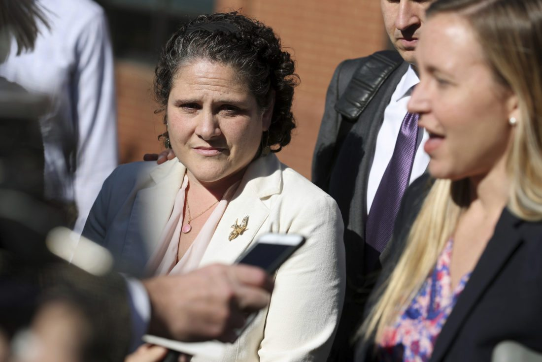 ASSOCIATED PRESS University of Virginia administrator Nicole Eramo, left, listens to attorney Libby Locke, right, speak with the media outside the federal courthouse in Charlottesville, Va., on Friday. A federal jury on Friday found Rolling Stone magazine, its publisher and a reporter defamed Eramo in a discredited story about gang rape at a fraternity house of the university.
