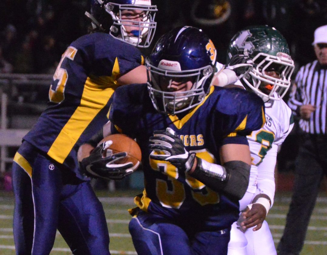 KATELYN HIBBARD/Sun-Gazette Nolan Ott of Montoursville runs Friday night vs. Lewisburg.