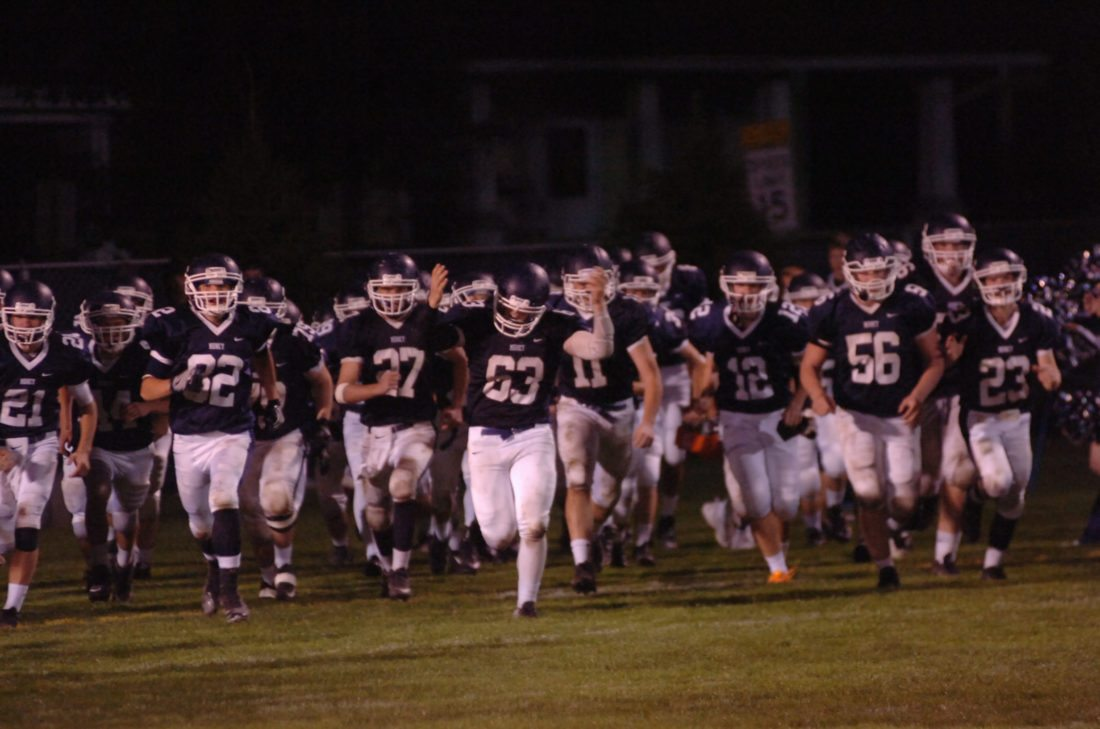 MARK NANCE/Sun-Gazette Members of Muncy's football team run onto the field prior to a game earlier this year against CMVT. Muncy defeated Wyalusing on Friday to earn a spot in the District 4 Class A championship game against Sayre.