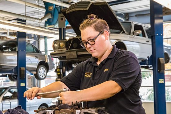 PHOTO PROVIDED Mya Ott works on repairing automotive parts at Milton Hershey School.