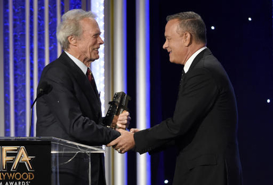 Clint Eastwood, left, presents Tom Hanks the Hollywood actor award at the 20th annual Hollywood Film Awards at the Beverly Hilton Hotel on Sunday, Nov. 6, 2016, in Beverly Hills, Calif. (Photo by Chris Pizzello/Invision/AP)