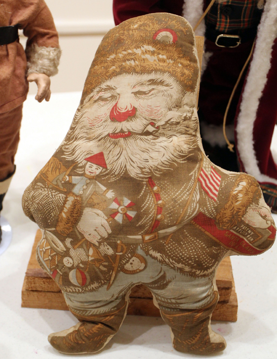 A handmade Santa pillow from an Edward Peck design from 1886 on display at the Taber Museum in Williamsport. KAREN VIBERT-KENNEDY/Sun-Gazette