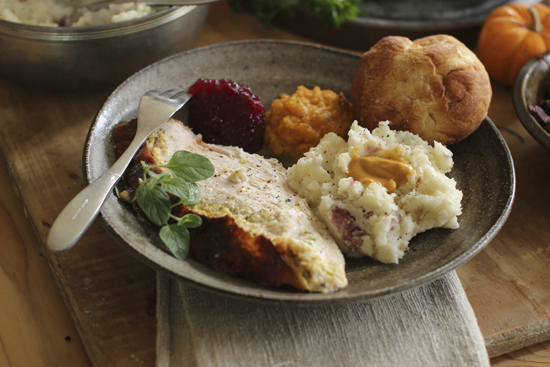 FILE - This Sept. 28, 2015, file photo shows Italian-style roast turkey breast in Concord, N.H. If you're not feeding a crowd for the holidays, then roasting a turkey breast could be the way to go. This dish is from a recipe by Sara Moulton. (AP Photo/Matthew Mead, File)