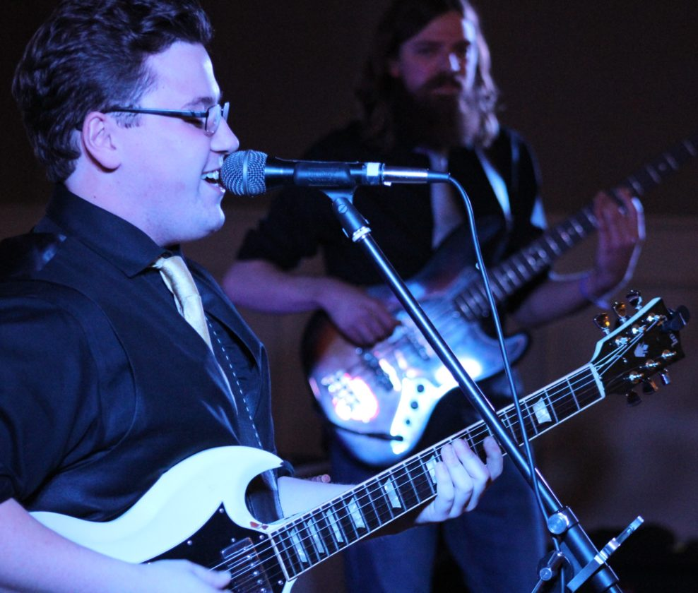 ANNE REINER/Sun-Gazette  Above, Gabe Stillman and the Billtown Giants play during the Fall Into the Blues fundraiser at the Genetti Hotel Saturday evening.