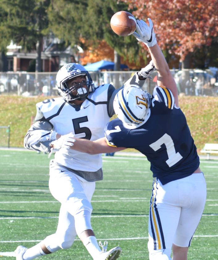 MARK NANCE/Sun-Gazette Mike Mulvhill (7) of Lycoming reaches for a pass as Stevenson's Daniel Flowe defends Saturday at Person Field.