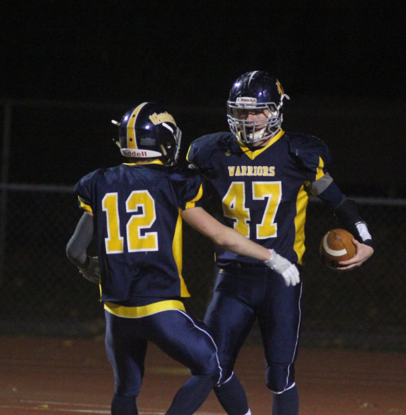 Montoursville's Mitchell Rothrock (47) and Riley Conboy celebrate a touchdown together last Friday against Danville in the District 4 Class AAA championship.