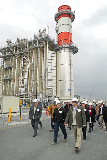 Guests walk by one of the towers during the tour of the Panda Power Funds Patriot Energy Center in Montgomery on Wednesday. Tours were given after the commissioning ceremony at the plant in Montgomery.  The Patriot Energy Center is the nation's second Marcellus shale-gas power plant. KAREN VIBERT-KENNEDY/Sun-Gazette