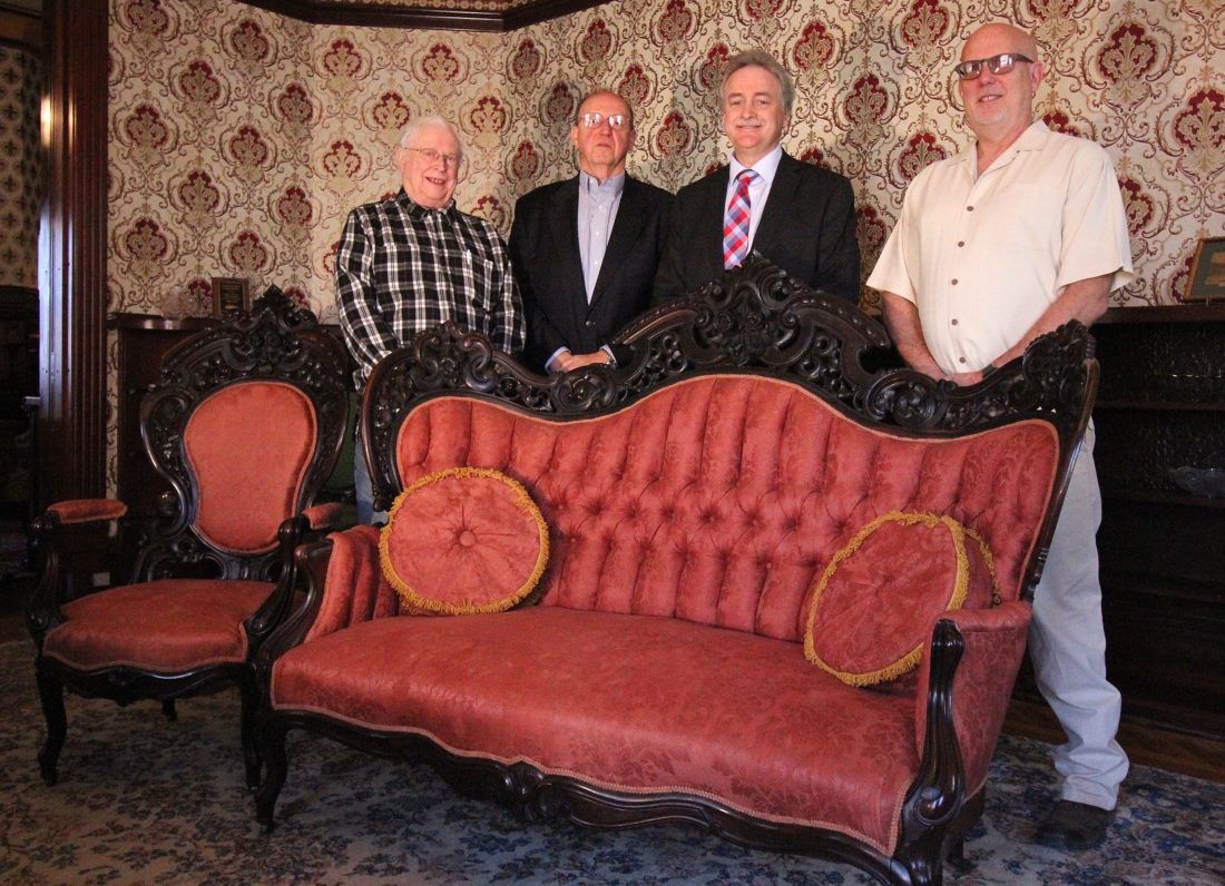 ANNE REINER/Sun-Gazette  The Rowley House Museum recently received a gift of antique J&J W. Meek furniture, donated by John and Anne Rich of Jersey Shore. Museum officials standing behind a few of the pieces are, from left, Eiderson Dean, vice chairman of the board of directors; William Hoffmann, tour coordinator; Robert K. Kane, museum curator and board secretary; and Edward Lyon, board chairman.