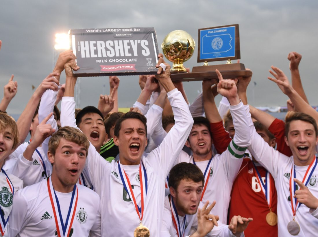 Lewisburg players hold their championship plaque Saturday at Hershey.