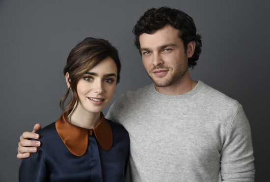 "In this Nov. 11, 2016 photo, Lily Collins, left, and Alden Ehrenreich, cast members in ""Rules Don't Apply,"" pose for a portrait at the Four Seasons Hotel in Los Angeles. (Photo by Chris Pizzello/Invision/AP)"