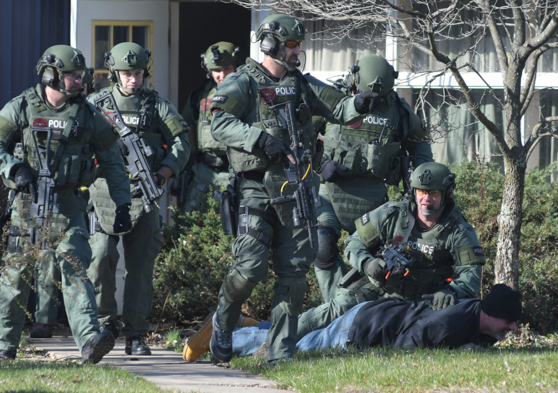 MARK NANCE/Sun-Gazette Members of the county's Special Response Team (SRT) take a gunman into custody during a drill by the Hostage Negotiantion Team at the former Bayard Plant in Old Lycoming Township on Wednesday.
