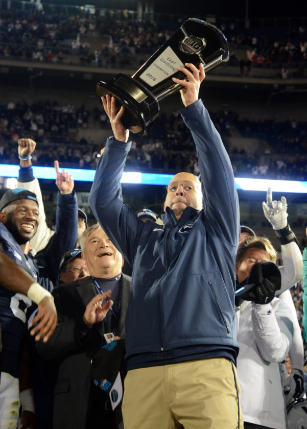 Penn State coachJames Franklin holds theBig TenEast Division championship trophy after Saturday's win over Michigan State on Saturday at Beaver Stadium. (PATRICKWAKSMUNSKI/For The Sun-Gazette)