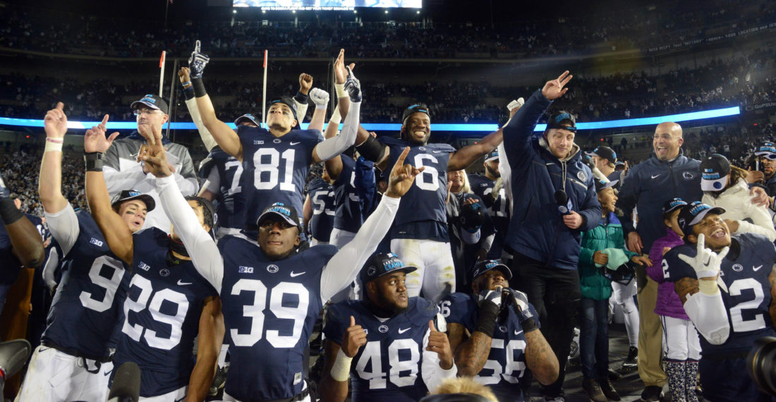 Members of the Penn State football team celebrate and pose for photos after defeating Michigan State on Saturday at Beaver Stadium to earn a trip to the Big Ten Championship next week. (PATRICK WAKSMUNSKI/For The Sun-Gazette)