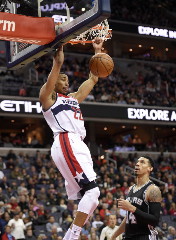 Washington Wizards forward Otto Porter Jr. (22) dunks over San Antonio Spurs guard Danny Green (14) during the first half of an NBA basketball game, Saturday, Nov. 26, 2016, in Washington. (AP Photo/Nick Wass)