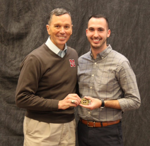 PHOTO PROVIDED Left, Mansfield University President Fran Hendricks awards Adam Murtland the Presidential Coin for Excellence.