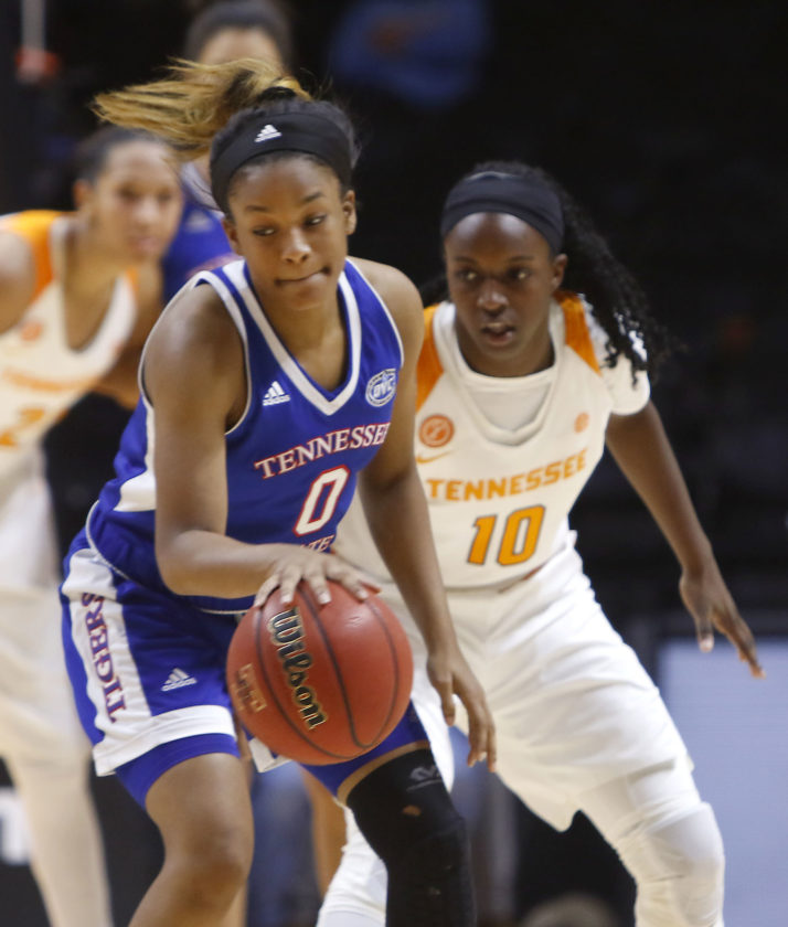 Tennessee State's Ciara Pettis drives the ball against Tennessee's Meme Jackson (10) during a game on  Wednesday in Knoxville, Tenn. (AP)