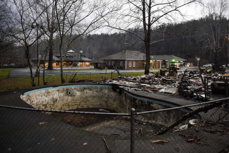 ASSOCIATEDPRESS A damaged pool is among the remains of Creek Place Efficiencies after a wildfire in Gatlinburg, Tenn., on Wednesday. Tornadoes that dropped out of the night sky killed several people in two states and injured at least a dozen more early Wednesday, adding to a seemingly biblical onslaught of drought, flood and fire plaguing the South. The storms tore through just as firefighters began to get control of wildfires that killed multiple people and damaged or wiped out more than 700 homes and businesses around the resort town of Gatlinburg.