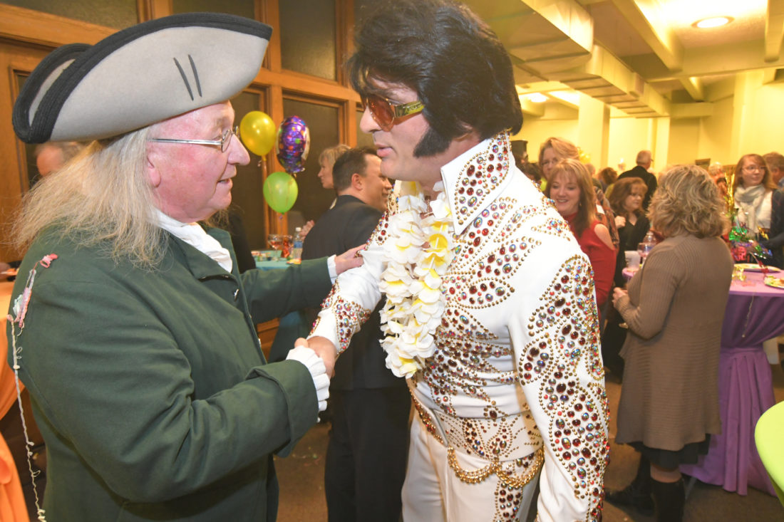 MARK NANCE/Sun-Gazette A Benjamin Franklin impersonator, left, and an Elvis Presley impersonator meet up during the Williamsport/Lycoming Chamber of Commerce's PM Exchange at the Williamsport Sun-Gazette on Thursday evening. The pair were on hand to celebrate the newspaper's 215th anniversary.