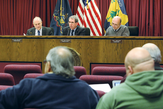 KAREN VIBERT-KENNEDY/Sun-Gazette Lycoming County commissioners Rick Mirabito, Jack McKearnan and Tony Mussare, from left to right, speak during the commissioners' meeting Thursday morning in Williamsport.