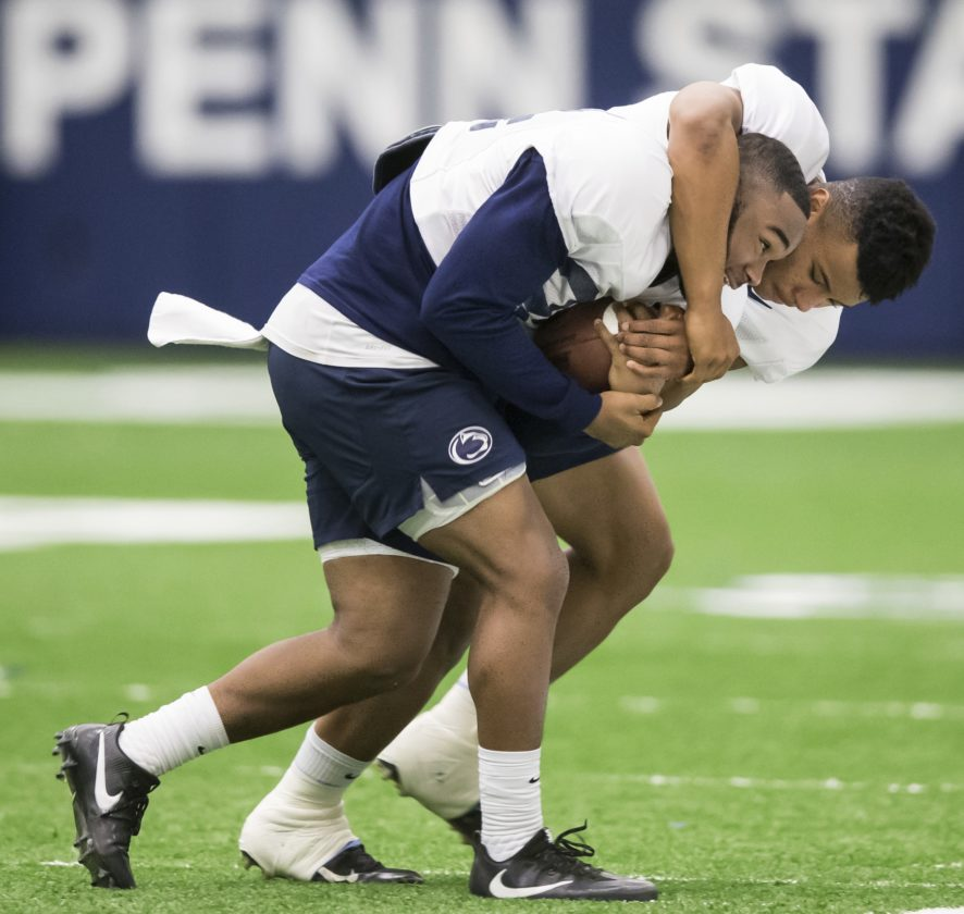 Penn State running backs Saquon Barkley and Miles Sanders work on a drill this week during practice.
