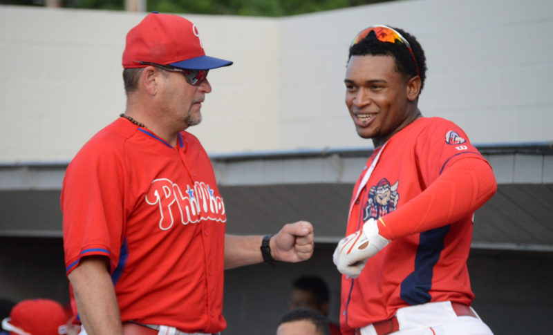 Williamsport Crosscutters manager Pat Borders, left, fist bumps one of his players during a game this past year at Bowman Field. The Philadelphia Phillies announced that Borders will return for his third season in Williamsport.