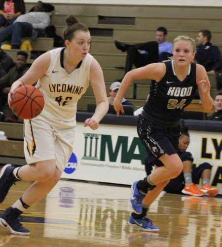 Haley Sipple of Lycoming drives the ball against Taylor McGaughey of Hood Saturday at Lamade Gym.