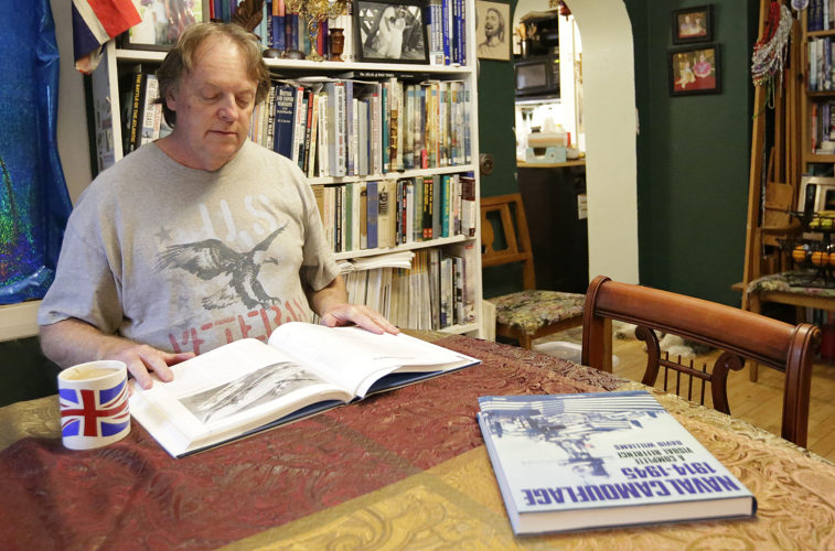 ASSOCIATED PRESS Steve Hayward reads a book in his Fond du Lac, Wis., home on Nov. 25.