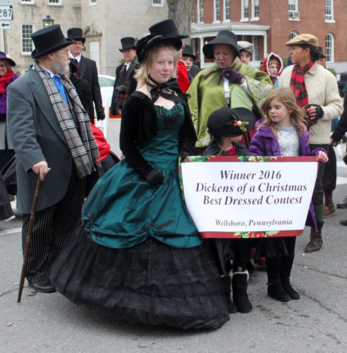 CHERYL R. CLARKE/Sun-Gazette Sky Debockler, 16, of Wellsboro, forefront, took first place in the first-ever Dickens Best Dressed contest Saturday in Wellsboro, walking away with over $1,000 in cash and prizes.