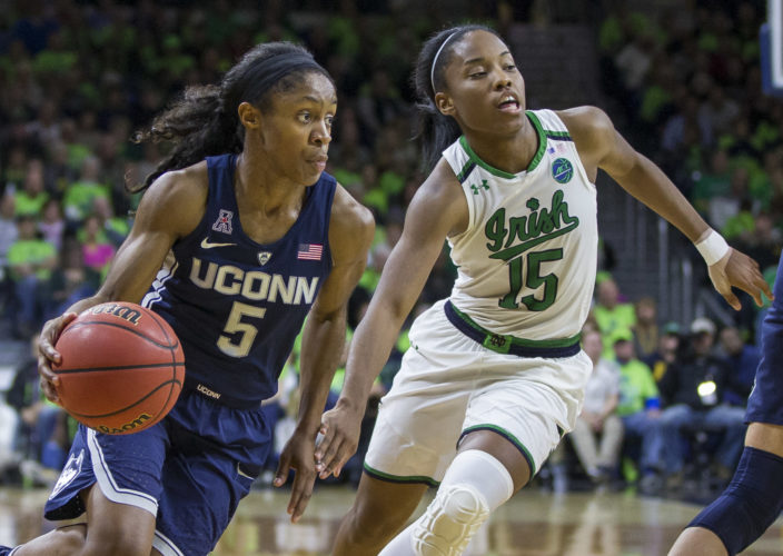 Connecticut's Crystal Dangerfield (5) drives by Notre Dame's Lindsay Allen (15) during the second half of an NCAA college basketball game Wednesday, Dec. 7, 2016, in South Bend, Ind. Connecticut won 72-61. (AP Photo/Robert Franklin)
