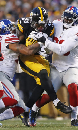Pittsburgh Steelers running back Le'Veon Bell (26) is tackled by New York Giants defensive end Jason Pierre-Paul (90) and linebacker Jonathan Casillas, left, during the first half of an NFL football game in Pittsburgh, Sunday, Dec. 4, 2016. (AP Photo/Jared Wickerham)