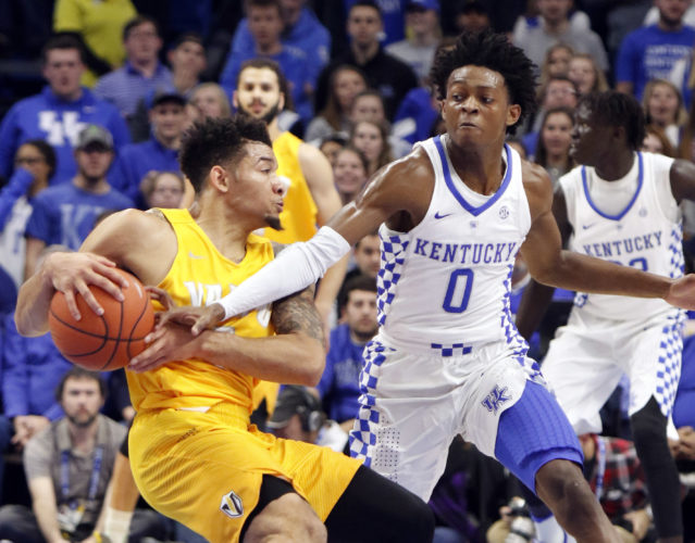 Valparaiso's Tevonn Walker is pressured by Kentucky's De'Aaron Fox (0) during the first half of an NCAA college basketball game, Wednesday, Dec. 7, 2016, in Lexington, Ky. (AP Photo/James Crisp)