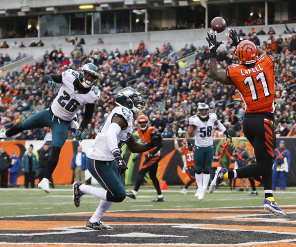 Cincinnati Bengals wide receiver Brandon LaFell catches a touchdown pass against Philadelphia Eagles defensive back Jaylen Watkins (26) and strong safety Malcolm Jenkins, center left, in Cincinnati on Sunday. After a strong first-half defensively, the Eagles defense has struggled.