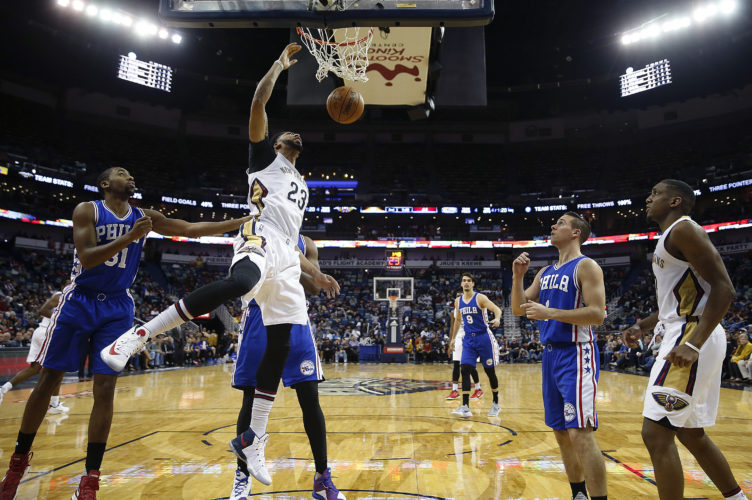 New Orleans Pelicans forward Anthony Davis (23) slam dunks in the first half of an NBA basketball game against the Philadelphia 76ers in New Orleans, Thursday, Dec. 8, 2016. (AP Photo/Gerald Herbert)