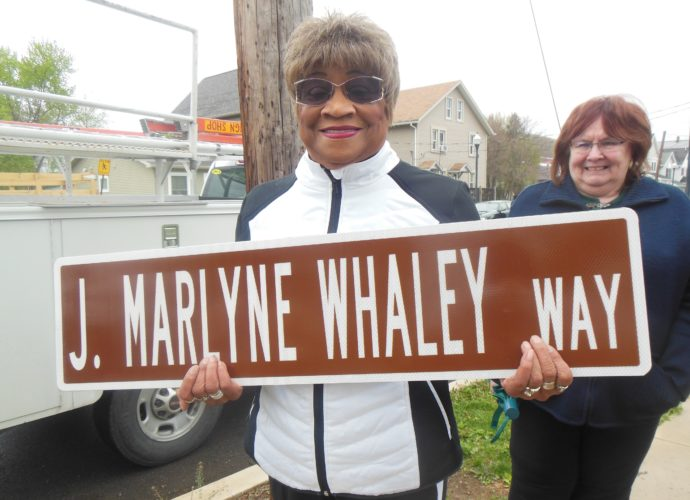 MARK MARONEY/Sun-Gazette Former City Councilwoman J. Marlyne Whaley is all smiles as she holds one of the five street signs made in her honor that will be put on intersections along Walnut Street between Little League Boulevard and High Street by an ordinance enacted by City Council. The signs show these sections to be forever known as J. Marlyne Whaley Way.